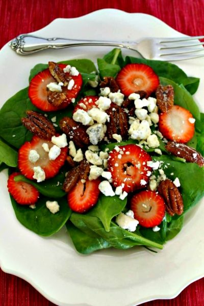 Make a fresh summer salad with spinach, strawberries, pecans, blue cheese and a delicious vinaigrette. Perfect for summer meals and BBQs.