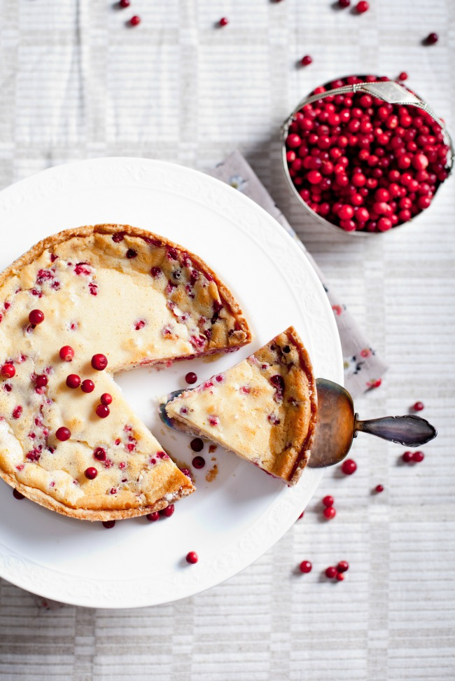 delicious holiday cheesecake with cranberries and eggnog