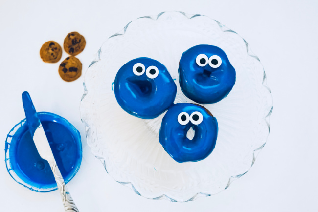 adding eyes to blue frosted donuts to look like cookie monster
