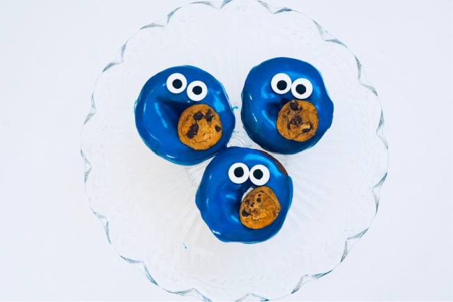completed cookie monster themed doughnuts