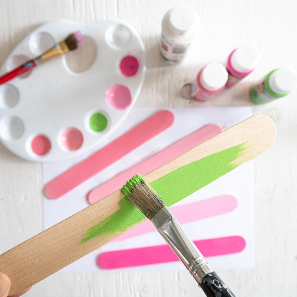 painting craft sticks green