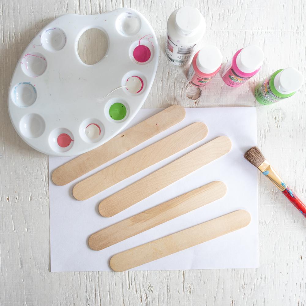 assembling supplies to paint craft sticks
