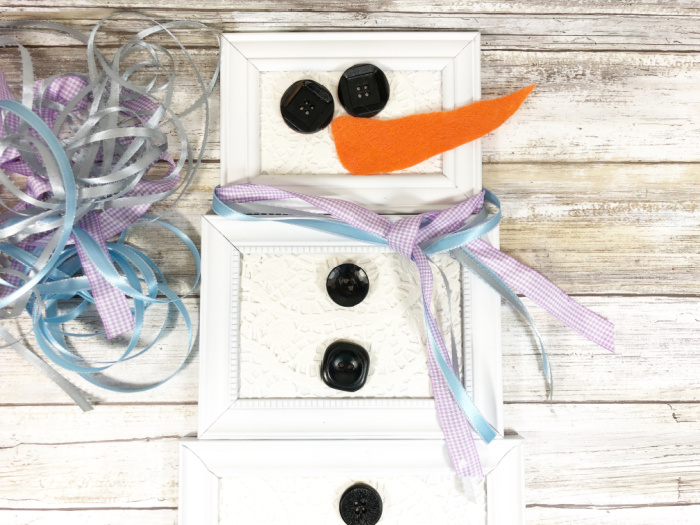adding ribbon scarf to picture frame snowman
