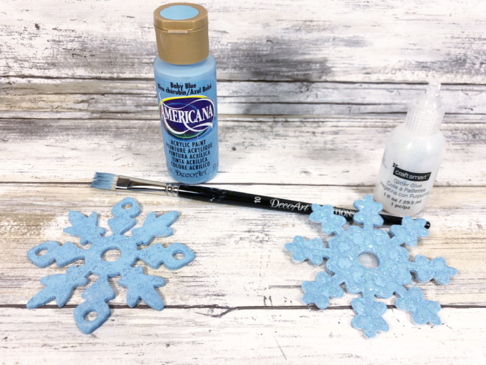 adding glitter glue to painted snowflakes