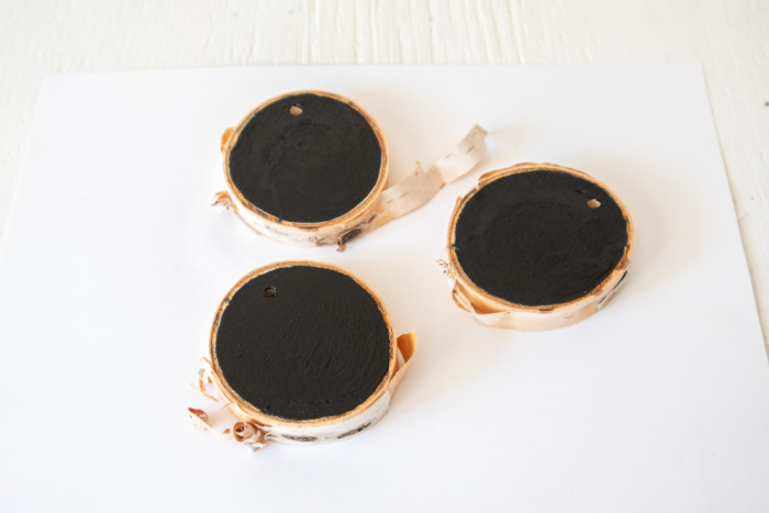 paint both sides of wood slice black and let dry thoroughly