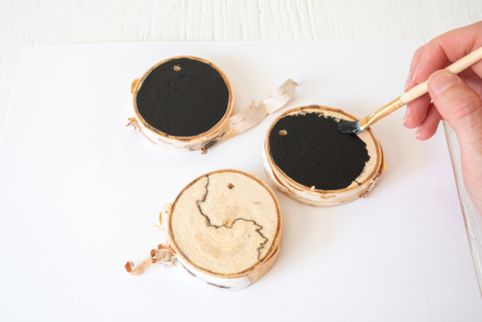 paint wood slice with black paint
