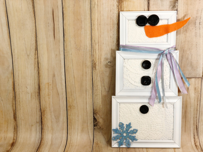 snowman made of picture frames