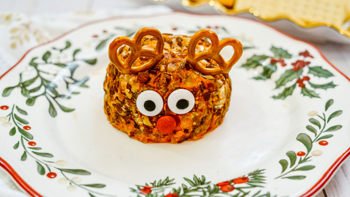 adding pretzel antlers to Rudolph cheeseball