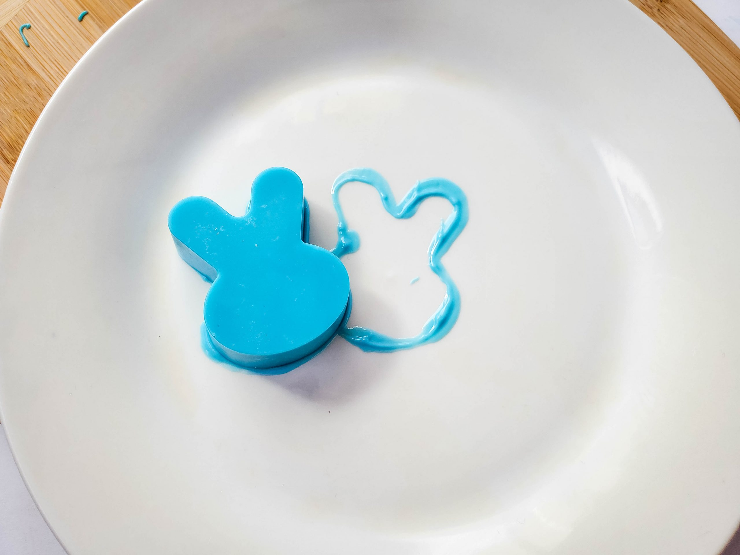 """a warmed plate melting the edge of the candy coated bunny to eventually seal the """"Peeps"""" cocoa bomb closed"""