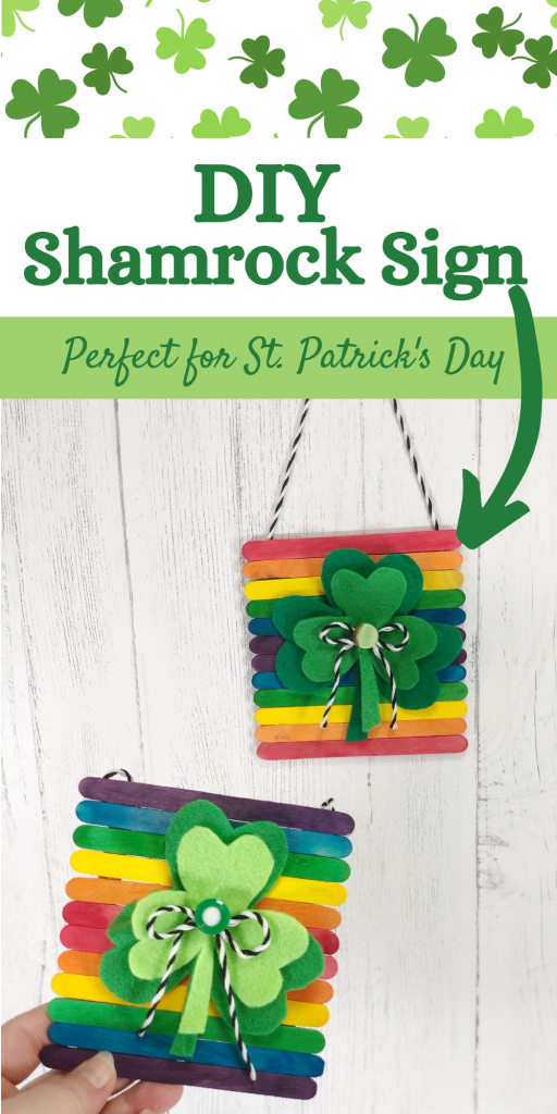 DIY shamrock sign with rainbow colored wooden sticks made from dollar store materials