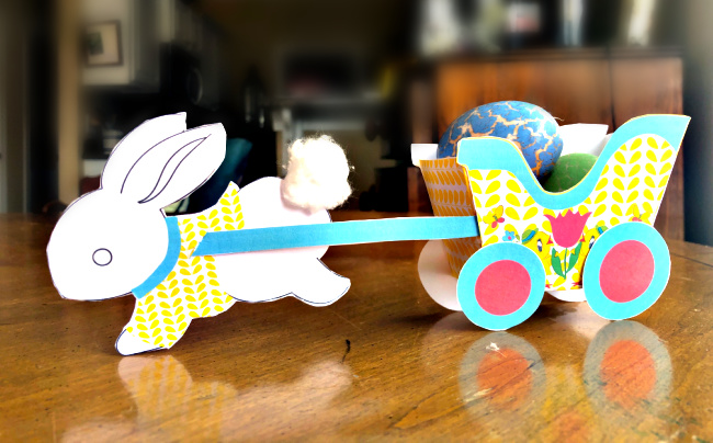 Easter bunny pulling a cart of treats