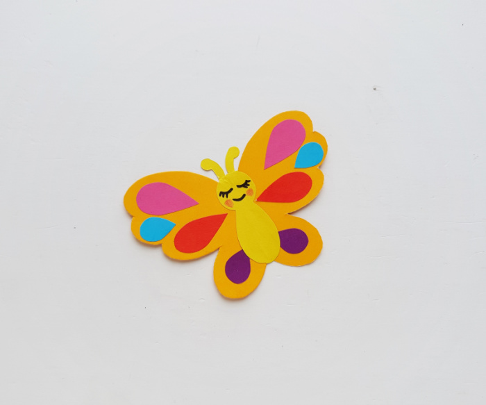 Adding face to the butterfly corner bookmark with Sharpie